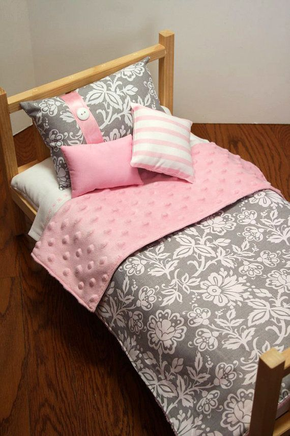 "So Sweet Pink and Grey  Soft and cozy 4 piece bedding for your 18"" to 20"" doll. Here is what's included:  • 1 Comforter (approx. 21"" x 16"") • 1 Main Pillow • 1 Rectangle Accent Pillow • 1 Square Accent Pillow  All comforters are backed with super soft dotted minky  (Please note that the SHEET SET is NOT included, but can be purchased separately here to coordinate with this set: http://www.etsy.com/shop/UrbanDreamz?section_id=13153387  We use a wide variety of high-quality designer fabrics…"