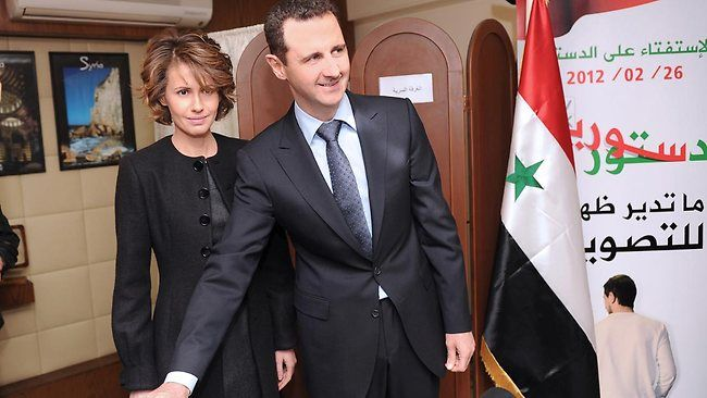 Syria's President Bashar al-Assad and his wife Asma vote during a referendum on a new constitution at a polling station in a Syrian TV station building in Damascus February 26, 2012. Description from blogs.cfr.org. I searched for this on bing.com/images