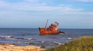 un barcu tiráu na mar