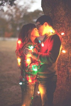 Christmas card idea  ...or tangle the kids in lights and Zach and I pose for a kiss... Doubt I could convince my husband of this one...