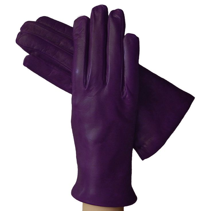 "The simple elegance and the softness make these purple women's Italian leather gloves a ""must have"" for every occasion. Lined in Cashmere. - 100% Cashmere lining - Italian kidskin leather - Made In It"