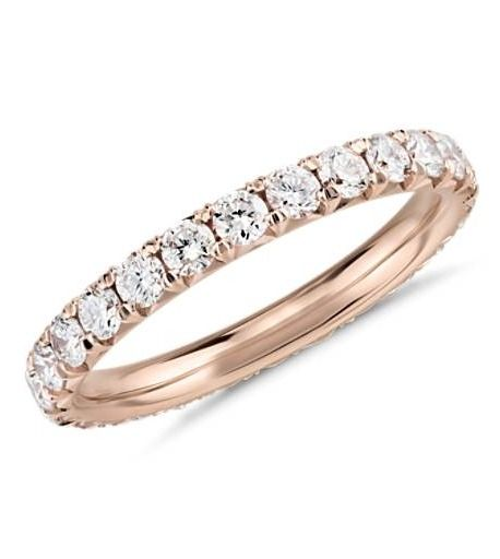 This diamond eternity ring showcases a full circle of round brilliant-cut diamonds set in polished 14k rose gold.