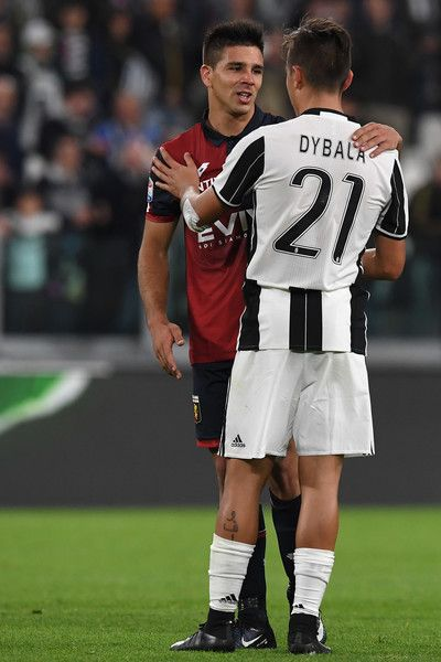 Paulo Dybala (R) of Juventus FC salutes Giovanni Simeone of Genoa CFC at the end of the Serie A match between Juventus FC and Genoa CFC at Juventus Stadium on April 23, 2017 in Turin, Italy.