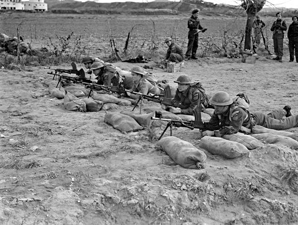 Italy (Misc.) - Infantrymen of the Royal 22e Regiment shooting target practice on a Bren gun range near Cattolica, Italy, ca. 24-25 November 1944. (L-R): Private L. Naspie, unknown, Privates R. Dodier, L. Richard, R. Lalancette, A. Belleg.