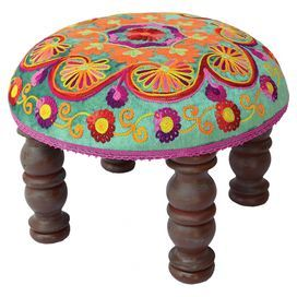 Mango wood footstool with a multicolor art silk seat. Product: Footstool Construction Material: Mango wood and art silk Color: Brown and multi Dimensions: 8.5 H x 12 Diameter Cleaning and Care: Spot clean only