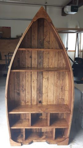 "handcrafted wooden canoe/boat shelf. custom orders. the ones pictures are stained in provincial and sealed with a coat of polyurethane. rough dimensions 69 3/4' tall, 8 3/4' deep and widest part is 34 3/4"" pictures are a few samples of what we have made. last one we made as a tv stand. check out our other stuff at www.facebook.com/ourneckofthewood"