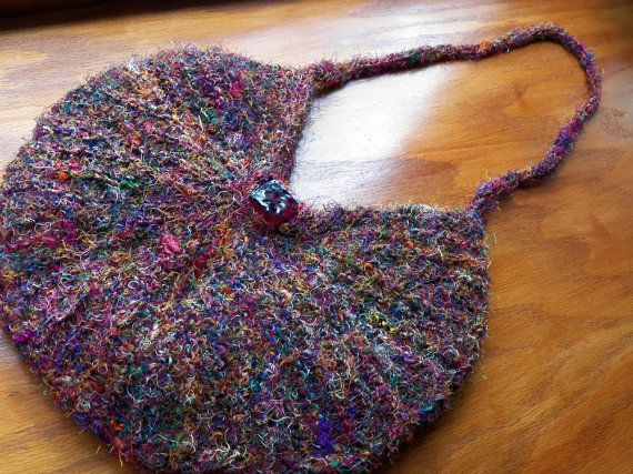 Sari Silk Shoulder Bag - OOAK.  Hand knit using recycled silk thrums (leftover silk on weaving looms, collected, then spun into silk threads for another use!) Lined with gold satin fabric, garnet bead closure. $45.00