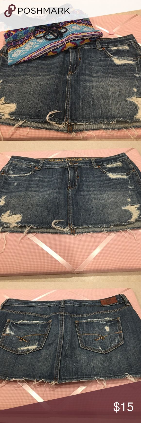 💠RUEHL distressed Jean skirt💠 Very fun and flirty distressed Jean skirt. In excellent condition and is approximately 11 inches long and approximately 16 inches along the waistline. Only worn maybe 2 times. Let me know if you have any questions. Thanks for looking. Ruehl No. 925 Skirts