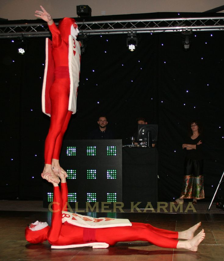 Red Card staged acrobalance act perfect for Alice in Wonderland themed events.