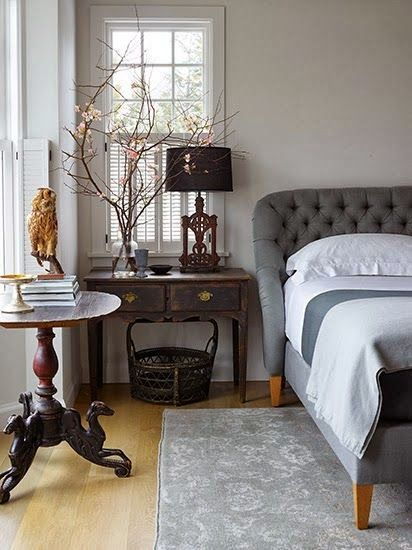 living with antiques, black lampshade, tufted headboard