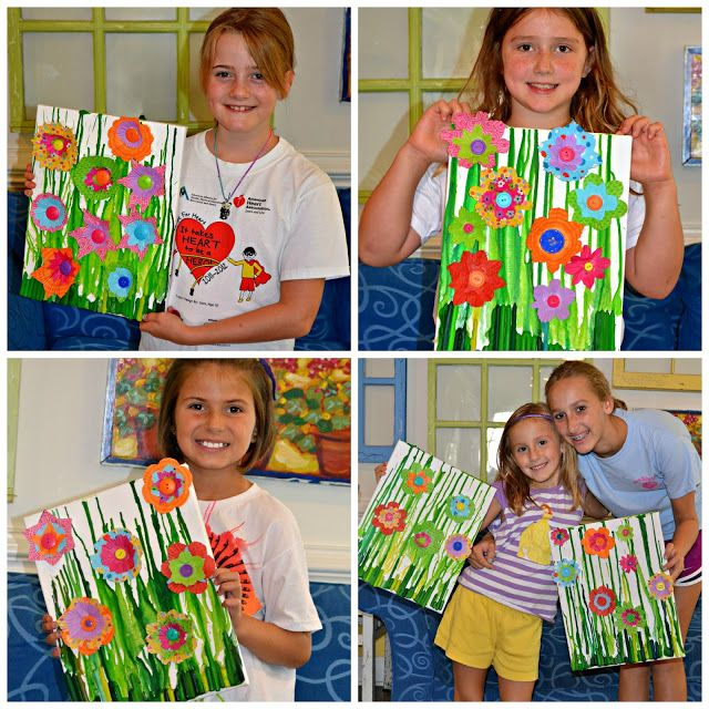 Melted Crayon Canvas turned into a Garden-- I used fake flowers instead of cupcake liners