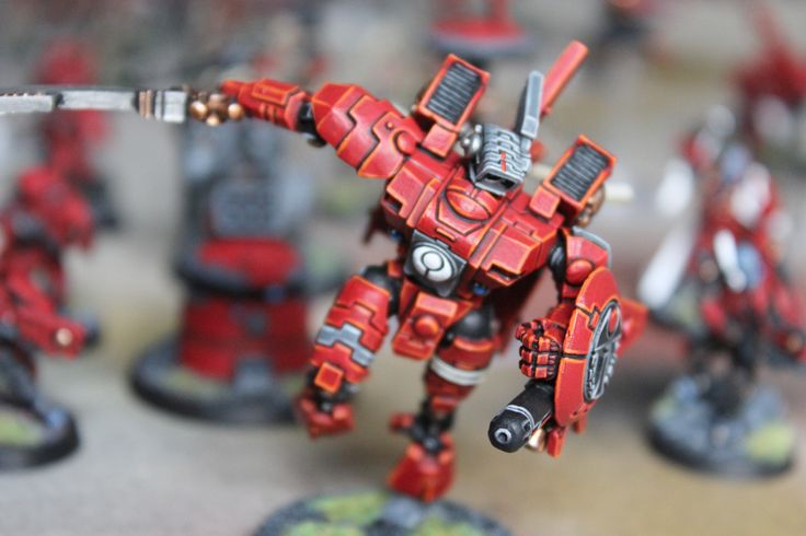 This one is painted at gold quality Tau Commander Farsight