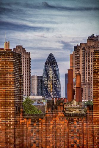 The London Gherkin and the Chimney Pots. The Gherkin is one of London's most iconic skyscrapers. Photo by CarlMilner on Flickr.