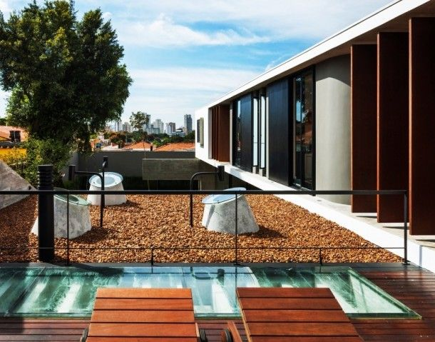 Architecture - Fascinating Balcony Design Of Casa Planalto With Light Brown Colored Wooden Sleeper Chairs And Square Shape Of Glass Skylight: Casa Planalto, House with Durable Concrete Walls and Scandinavian Furniture