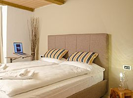 Lounge-book ecodesign in a resience to use laptop and watch video on the bed