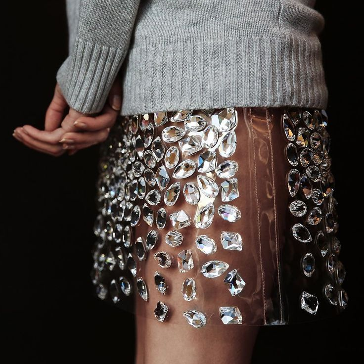 Michael Kors / @michaelkors - Michael Kors gets up close and personal with his bejeweled PVC skirt.                                                                                                                                                     More