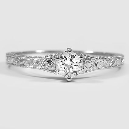 """14K Rose Gold Hudson Ring with a 0.33 carat diamond. The rose gold make the diamond look pinkish in the light and it's so delicate, simple, and stunning! I love the 6-prong setting too. [1] Solitaire ring--one central diamond--to signify """"you are the one"""" [2] 0.33 carat for the Holy Trinity [3] Round cut diamond for endless circle/endless love [4] Diamond stone symbolizes purity, virtue, holiness [5] Swirls on the sides look traditionally Catholic/vintage"""