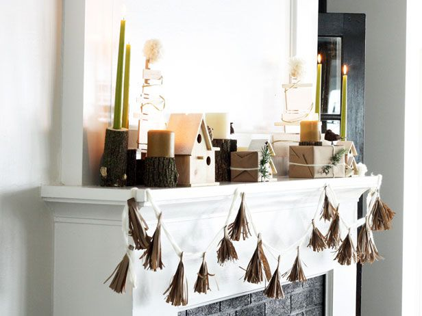 A Natural and Sophisticated Christmas Mantel: Riddled with warm and neutral details, this fireplace mantel design combines a clean Scandinavian aesthetic with rustic textures. From DIYnetwork.com