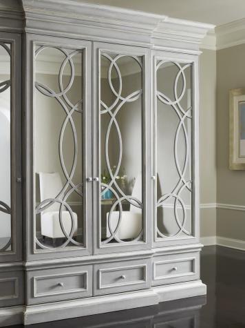Beautiful circular design fretwork to wardrobes, with mirror behind
