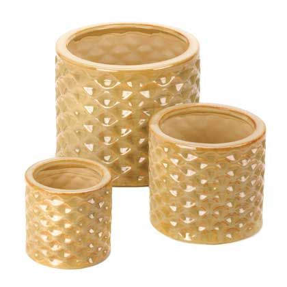 This planter set includes three different-sized pots to ensure your plants get the proper home. The glossy taupe finish and faceted design of this trio catches the sunlight to enhance your greenery with style. Drain hole at the bottom of each planter.