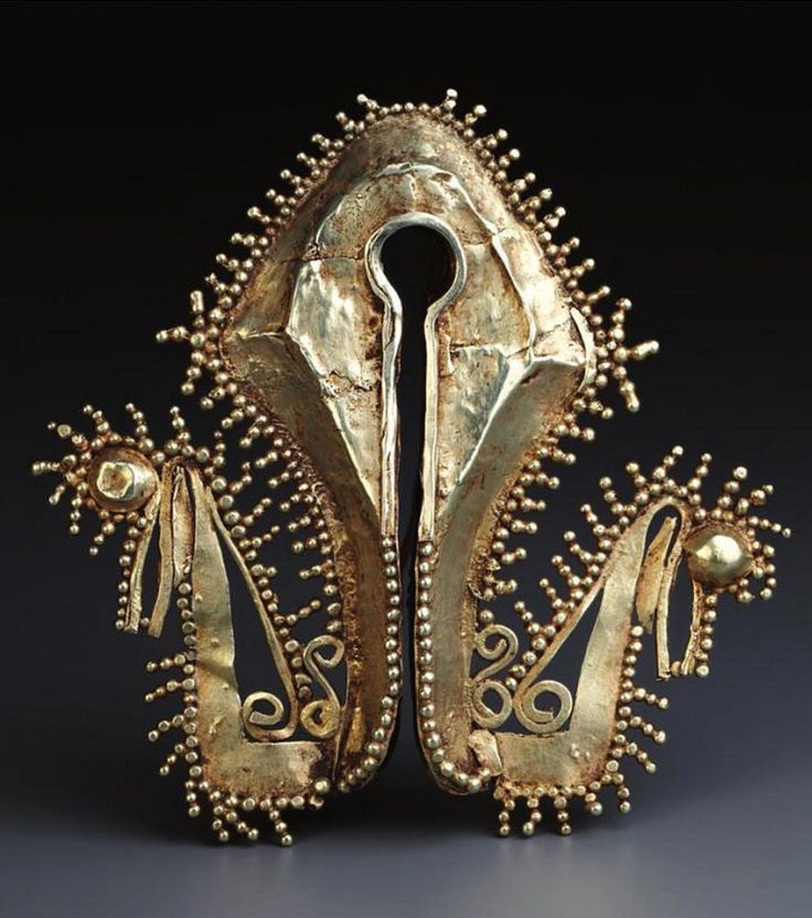 Indonesia ~ West Sumba | Elongated pendant (mamuli); gold alloy | 19th century or earlier || Source: 'Gold Jewellery of the Indonesian Archipelago', page 147