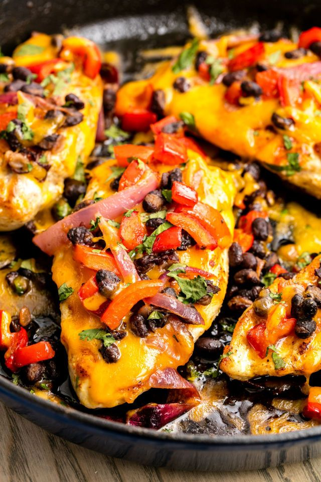 Santa Fe Skillet Chicken: Tex-Mex at its finest: This skillet chicken is topped with melty cheddar and a delicious black bean-red onion mixture. - Delish.com