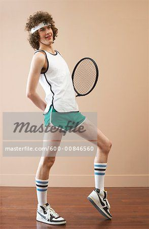 Stock photo of Retro style Young Man Holding Tennis Racquet; Premium Royalty-Free, 600-00846560 © Masterfile. All rights reserved.