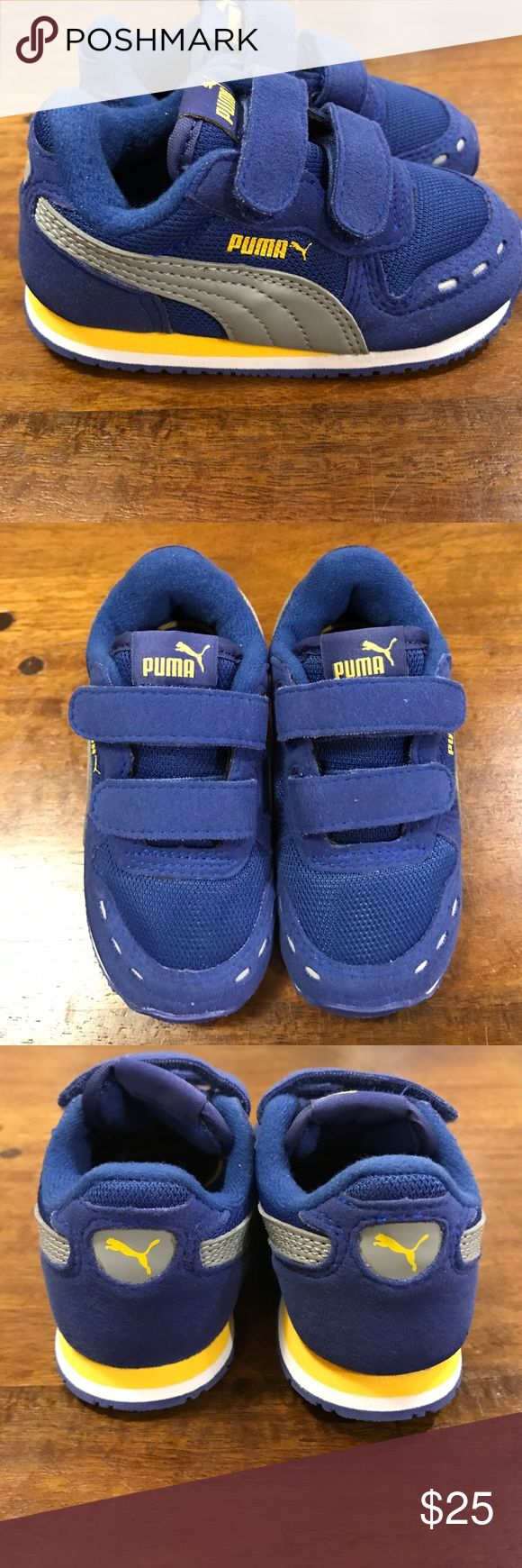 Brand new baby blue puma sneakers Brand new baby blue puma sneakers with yellow stripes. Double Velcro closure. Puma Shoes Sneakers