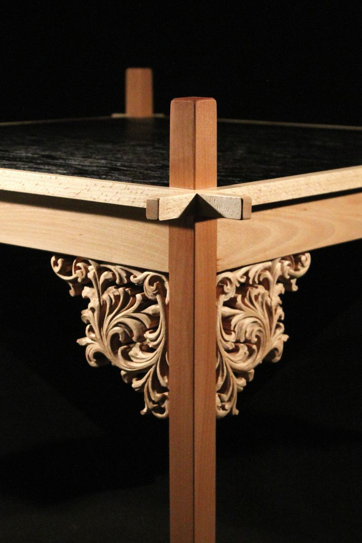 Coffee table made from oak and beech. The structure is made without using the finger screws or nails.Deck finished in technology shou sugi ban.All covered with natural oil.Hand-carved decorative motif. Caved detail www.drewnoikamien.pl