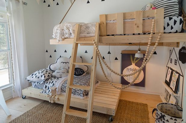 Adorable children's room with wooden beds, printed bedding and room to play and imagine   Urbanology Designs