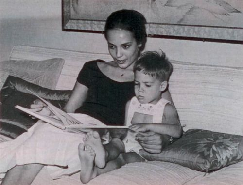 Anna Kashfi reading a book to her son Christian Brando, son of Marlon Brando