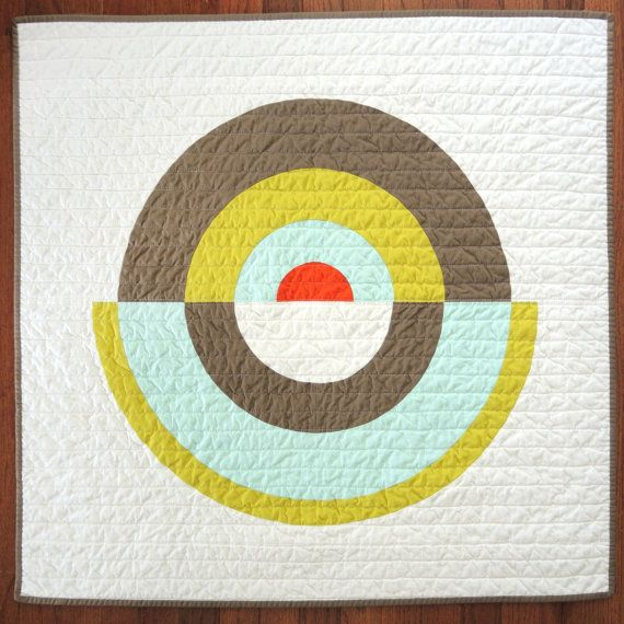 50% OFF NOW!  Graphic but minimal art/wall quilt or baby blanket. Concentric rings in various widths and off set colors: Kona Bonzai, Herb, Ice Frappe, Tangerine on a Snow background. Khaki back and Herb binding. The best part is theres no up or down! Its square, and easily switched up. 32x32 Machine pieced and quilted with hand-finished binding. Machine wash and dry (gentle, cold and low or line dry). Recently featured in Japanese exhibit - woot!  Adult/larger sizes available