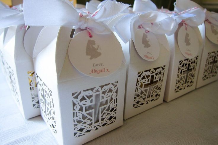 Favor boxes for a 1st Holy Communion containing her favourite chocolates, Minstrels. First Holy Communion dessert table