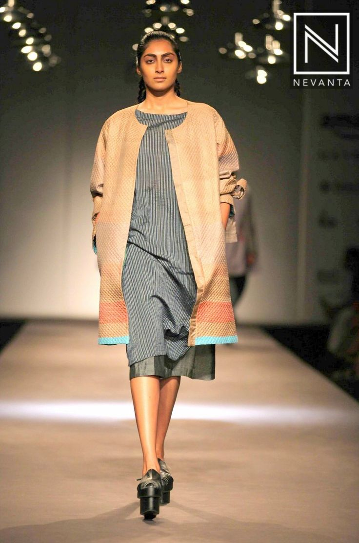 A striped kurti-dress paired with a long #jacket by #Akaaro