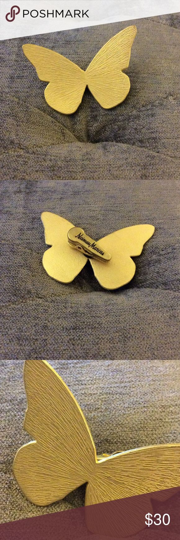 Neiman Marcus Gold Butterfly Clip Beautiful gold butterfly clip from Neiman Marcus.  Never used and would be cute on a jacket, hat or bag. Neiman Marcus Jewelry Brooches