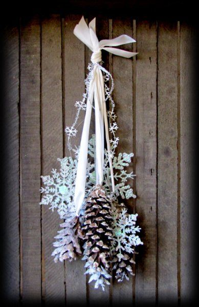 How cute, inexpensive snowflakes and pinecones with pretty ribbon.