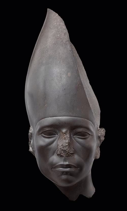 """Head of a statue of Amenemhat III wearing the white crown, Egypt, 12th dynasty, reign of Amenemhat III, ca.1859–1813 BC (acquired in Cairo, 1894). H: 18 x W: 7"""" (47 x 18.5 cm)"""