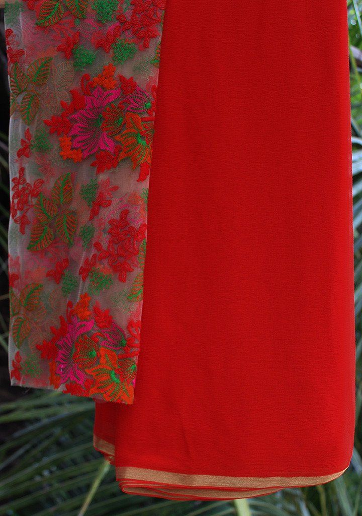 Red chiffon saree with embroidered blouse piece