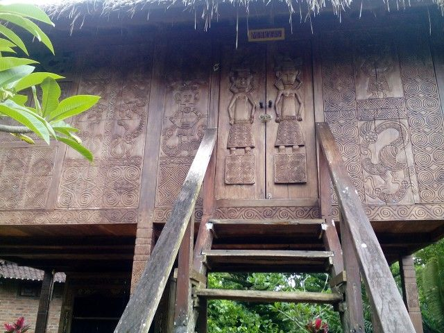 This is a stilt house from Timor; rent it for a unique holiday experinece. The bed is modern and comfortable, the 'outhouse' toilet and shower, are built on the ground.