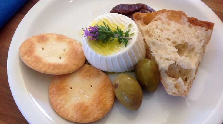 Merill summer starter - Maltese cheese (gbejna) garnished with wild thyme and other local ingredients