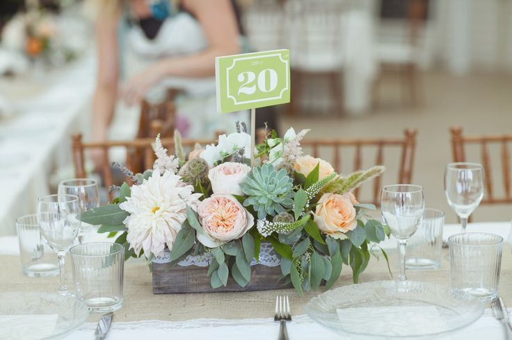 Some tables had centerpieces composed of wood planter boxes filled with dahlias, astilbe, succulents, scabiosa pods, anemones and Juliet garden roses.