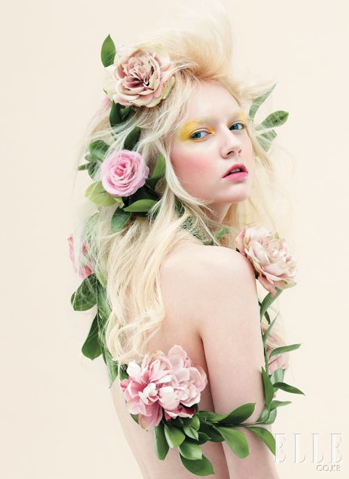 Elle Korea: this would be cool for Halloween as Poison Ivy or a fairy... Mucha art nouveau flower hair with a pop of neon eye shadow make up.... whimsy