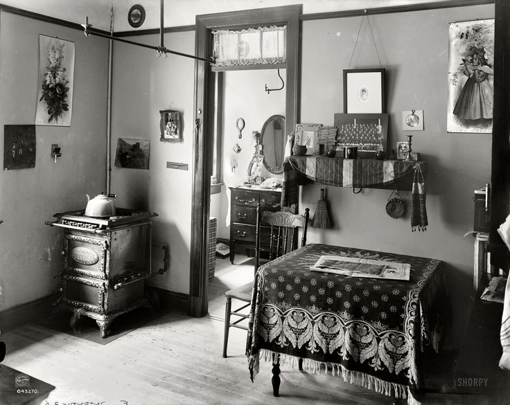 """Circa 1905. """"New York tenement."""" With a number of tiny inhabitants in evidence. Dry plate glass negative, Detroit Publishing Company."""