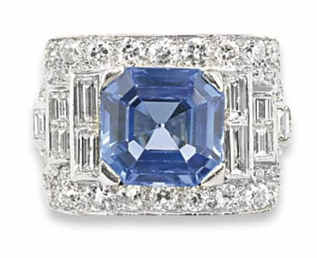 A SAPPHIRE AND DIAMOND RING, BY BULGARI   The octagonal-shaped sapphire set in baguette and brilliant-cut diamond-set band, ring size 6  Signed Bulgari