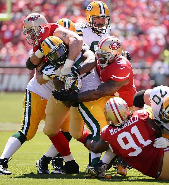 Leading Off: Pictures of the Week - Photos - SI.com - Packers running back Eddie Lacy (27) is hit high and low by 49ers defensive tackles Ray McDonald (91) and Justin Smith (94), and linebacker NaVorro Bowman (53), during San Francisco's 34-28 victory over Green Bay on Sept. 8. The Packers had upgraded their anemic rushing attack by drafting Lacy in the second round last spring, but they rushed for just 63 yards on 19 carries against the 49ers' rugged defense.