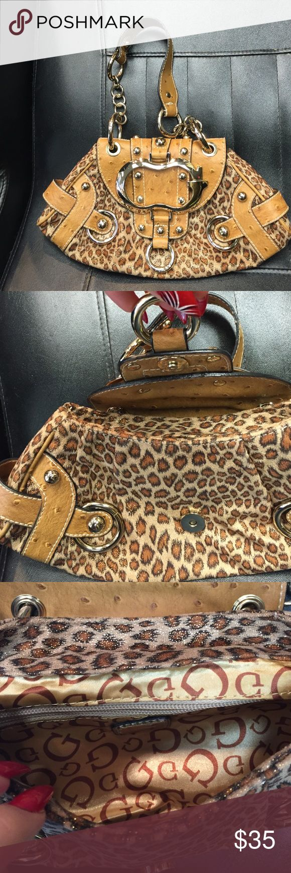 Guess animal leopard  print purse I dont remember ever wearing it , just has been sitting in my closet Guess Bags Mini Bags