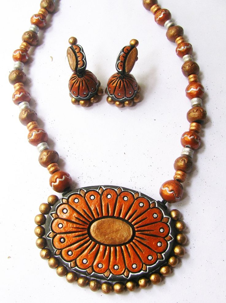 A beautiful and ethnic terracotta set which comes with matching jhumkas. Cost- Rs 1100/-