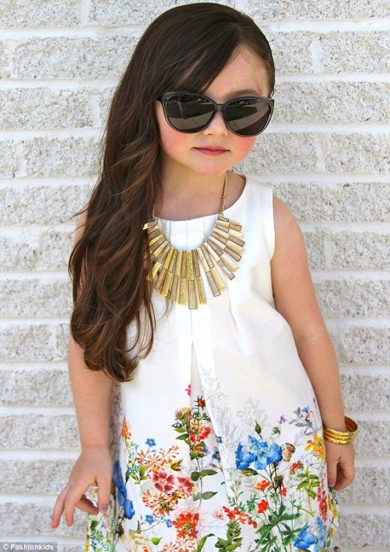 On trend with her printed floral dress and shades. #welldressed #cutie #itstartsyoung