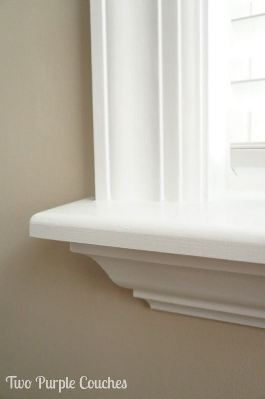 Detail of crown moulding added beneath a custom-cut window sill. Love this beautiful look! via www.twopurplecouches.com