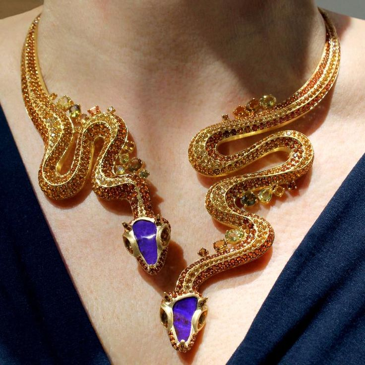 Two horned vipers with electric-blue opal heads coil round the neck, their heads resting seductively low on the décolletage, in this one-of-a-kind necklace from Lydia Courteille's Sahara collection.